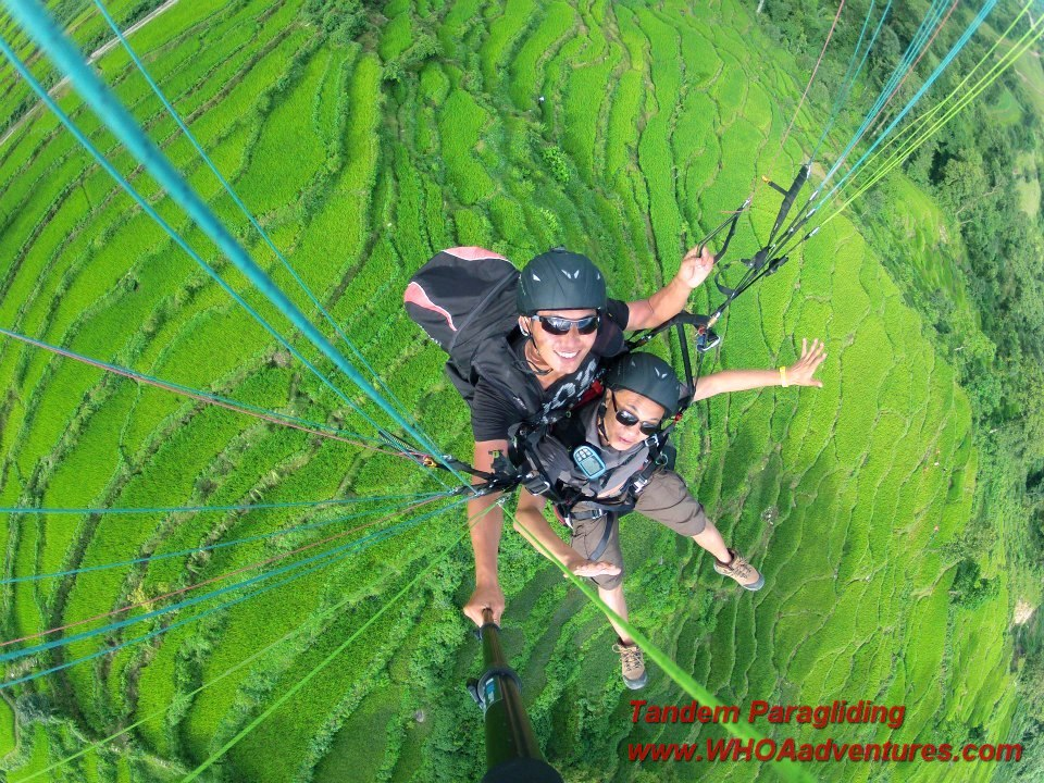 One of the Tandem Paragliding Pilots with  a guest passenger in Nepal